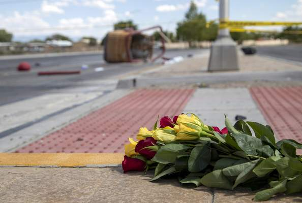 FILE - In this June 26, 2021, file photo, a bouquet of flowers from a mourner is placed near the basket of a hot air balloon which crashed in Albuquerque, N.M. (AP Photo/Andres Leighton, File)