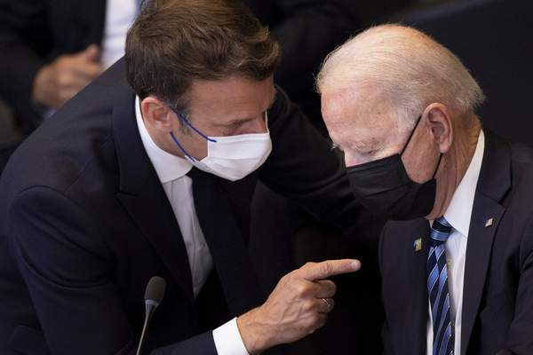 FILE - In this June 14, 2021 file photo, U.S. President Joe Biden, right, speaks with French President Emmanuel Macron during a plenary session during a NATO summit at NATO headquarters in Brussels. (Brendan Smialowski, Pool via AP, File)
