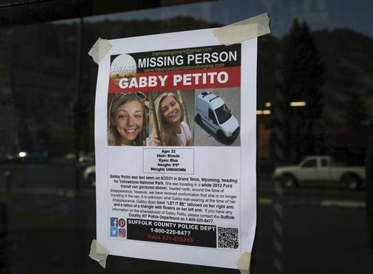 This Thursday, Sept. 16, 2021, photo, shows a Suffolk County Police Department missing person poster for Gabby Petito posted in Jakson, Wyo. Petito, 22, vanished while on a cross-country trip in a converted camper van with her boyfriend. (AP Photo/Amber Baesler)
