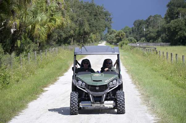 Florida Fish and Wildlife Commission officers ride up a private road near the entrance of the Carlton Reserve during a search for Brian Laundrie, Tuesday, Sept. 21, 2021, in Venice, Fla. (AP Photo/Phelan M. Ebenhack)