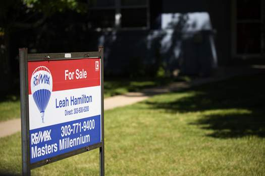 Existing Home Sales A sale sign stands outside a home on the market Tuesday, Sept. 21, 2021, in southeast Denver. (AP Photo/David Zalubowski) (David Zalubowski STF)