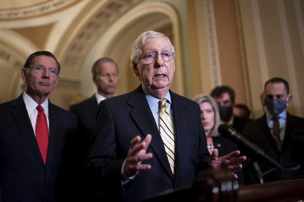Senate Minority Leader Mitch McConnell, R-Ky., joined from left by Sen. John Barrasso, R-Wyo., and Minority Whip John Thune, R-S.D., speaks to reporters after a weekly GOP strategy meeting, at the Capitol in Washington, Tuesday, Sept. 21, 2021. (AP Photo/J. Scott Applewhite)