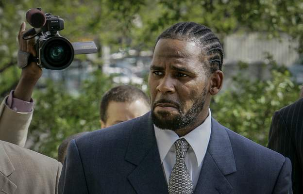 FILE - This photo from Friday May 9, 2008, shows R. Kelly arriving for the first day of jury selection in his child pornography trial at the Cook County Criminal Courthouse in Chicago. (AP Photo/Charles Rex Arbogast, File)
