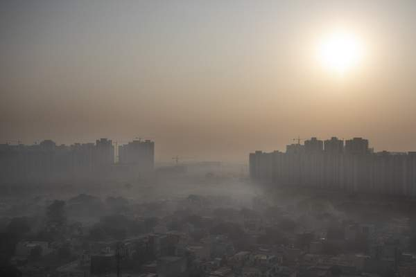 FILE - In this Friday, Oct. 16, 2020 file photo, morning haze envelops the skyline on the outskirts of New Delhi, India. (AP Photo/Altaf Qadri, File)