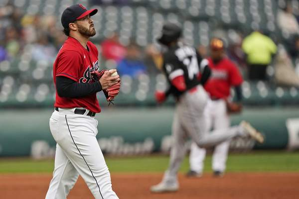 Cleveland Indians starting pitcher Aaron Civale, left, waits for Chicago White Sox's Eloy Jimenez to run the bases after Jimenez hit a solo home run in the second inning in the first baseball game of a doubleheader, Thursday, Sept. 23, 2021, in Cleveland. (AP Photo/Tony Dejak)
