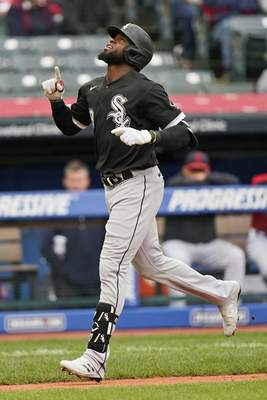 Chicago White Sox's Luis Robert runs the bases after hitting a solo home run in the second inning in the first baseball game of a doubleheader against the Cleveland Indians, Thursday, Sept. 23, 2021, in Cleveland. (AP Photo/Tony Dejak)