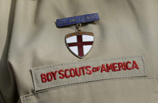 FILE - This Feb. 4, 2013 file photo shows a close up of a Boy Scout uniform in Irving, Texas. (AP Photo/Tony Gutierrez, File)