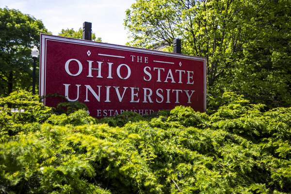 FILE - This May 8, 2019, file photo, shows a sign for Ohio State University in Columbus, Ohio. On Wednesday, Sept. 22, 2021, a federal judge dismissed some of the biggest remaining lawsuits over Ohio State's failure to stop decades-old sexual abuse by now-deceased team doctor Richard Strauss, saying it's indisputable he abused hundreds of young men but agreeing with OSU's argument that the legal window for such claims had passed. (AP Photo/Angie Wang, File)