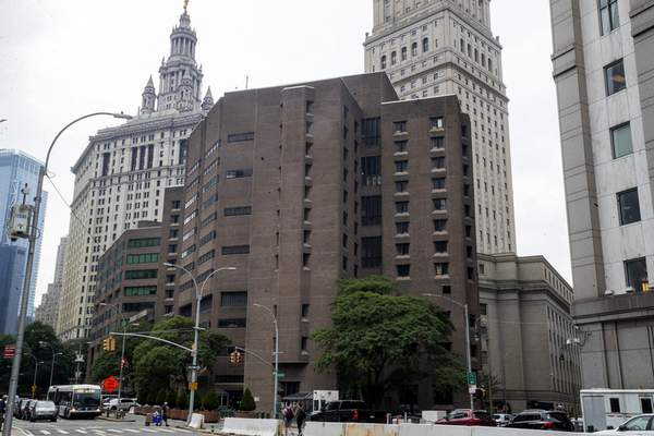 FILE - This Aug. 13, 2019, file photo, shows the Metropolitan Correctional Center in New York. (AP Photo/Mary Altaffer, File)
