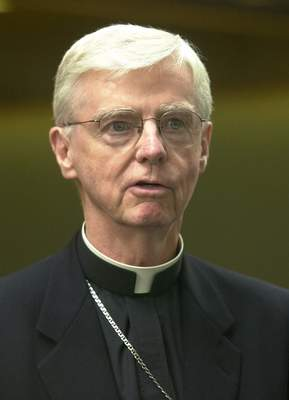 FILE †New Hampshire Bishop John McCormack speaks to reporters, in Manchester, N.H., in this Thursday, Aug. 15, 2002 file photo. (AP Photo/Jim Cole, File)