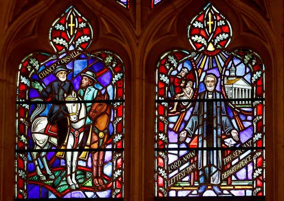 FILE - This Wednesday, Sept. 6, 2017 file photo shows stained glass windows depicting two Confederate generals at the Washington National Cathedral. (AP Photo/Carolyn Kaster)