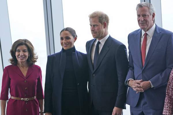 Meghan Markle, second from left, and Prince Harry, second from right, pose for pictures with New York governor Kathy Hochul, left and New York City mayor Bill de Blasio at the observatory in One World Trade in New York, Thursday, Sept. 23, 2021. (AP Photo/Seth Wenig)
