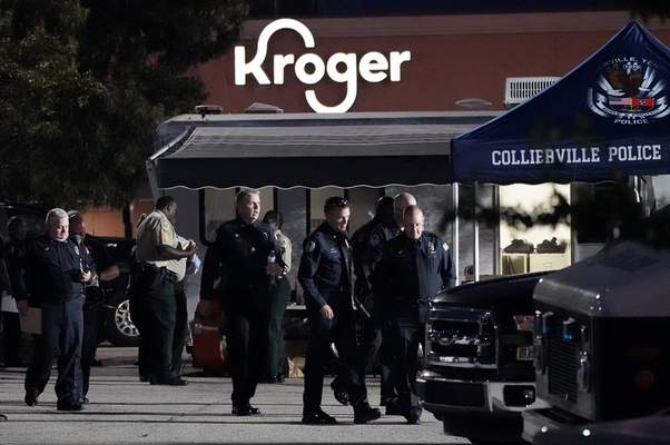 Associated Press Law enforcement personnel investigate a shooting Thursday at  a Kroger  store  in Collierville, Tenn. Police say a gunman attacked people in the store and killed at least one person and wounded 12 others before the suspect was found dead.