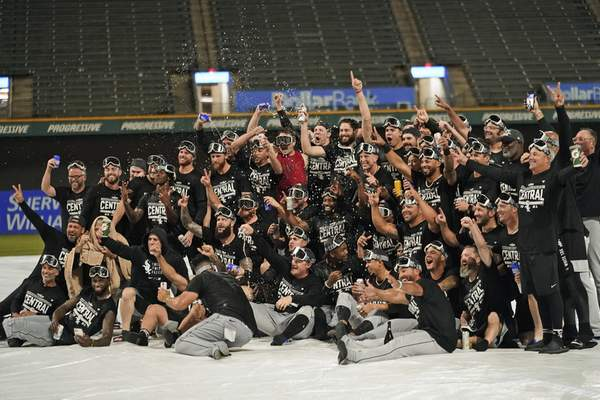 Associated Press Chicago White Sox team members celebrate on the field in Cleveland after clinching the AL Central title Thursday.