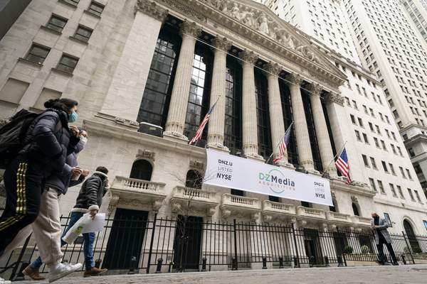 FILE - In this Jan. 27, 2021 file photo, pedestrians pass the New York Stock Exchange, in New York. Stocks are off to a weak start on Wall Street Friday, Sept. 24, losing momentum after a two-day rally. (AP Photo/John Minchillo, File)