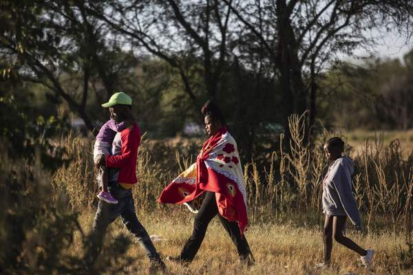 Haitian migrants look for a place to wade the Rio Grande to cross the U.S.-Mexico border from Ciudad Acuña, Mexico, Thursday, Sept. 23, 2021, after Mexican security forces deployed to block access to the river to immigrants. (AP Photo/Felix Marquez)