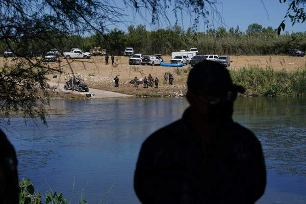 A Mexican security agent stands on the bank of the Rio Grande river as agents work to block access to the river so migrants can't use it to cross the U.S.-Mexico border, in Ciudad Acuna, Mexico, Thursday, Sept. 23, 2021, across from Del Rio, Texas. (AP Photo/Fernando Llano)