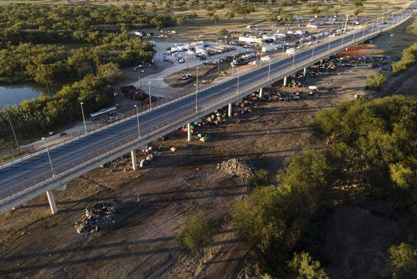 An area where about 14,000 migrants, many from Haiti, were camping out along the Del Rio International Bridge is seen with a large portion of the area cleaned up as authorities continue to process and remove them, Thursday, Sept. 23, 2021, in Del Rio, Texas. (AP Photo/Julio Cortez)