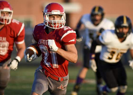 Mike Moore | The Journal Gazette Adams Central running back Alex Currie runs for a touchdown Friday night against South Adams during the first quarter in Monroe. Currie, a senior, scored three touchdowns.