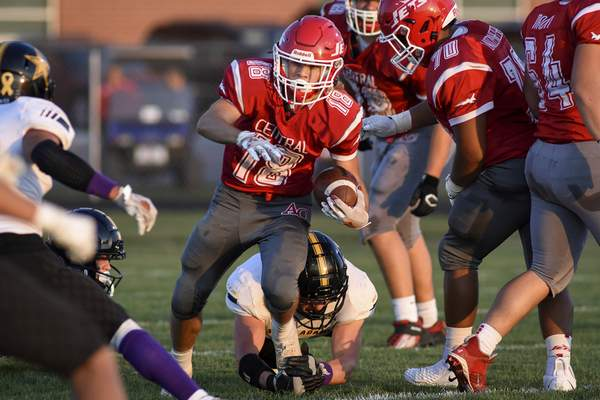 Mike Moore | The Journal Gazette Adams Central wide receiver Nick Neunschwander advances the ball in the first quarter against South Adams Friday.