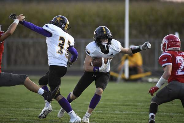 Mike Moore | The Journal Gazette South Adams running back Brady Beall looks for an opening against Adams Central.