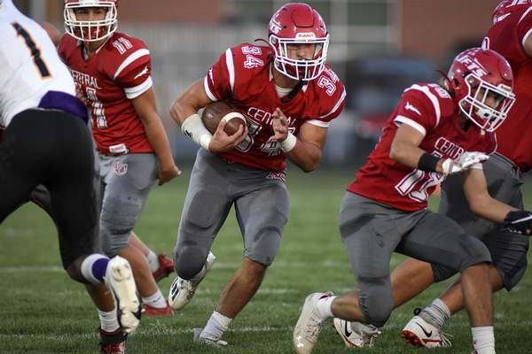 Mike Moore | The Journal Gazette Adams Central running Blake Heyerly carries the ball in the first quarter against South Adams in Monroe on Friday.