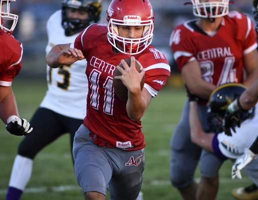 Mike Moore | The Journal Gazette Adams Central quarterback Ryan Black carries the ball in the first quarter against South Adams in Monroe on Friday.