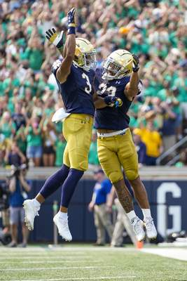 Associated Press Notre Dame running back Kyren Williams, right, and wide receiver Avery Davis celebrate following a touchdown against Toledo on Sept. 11 in South Bend.