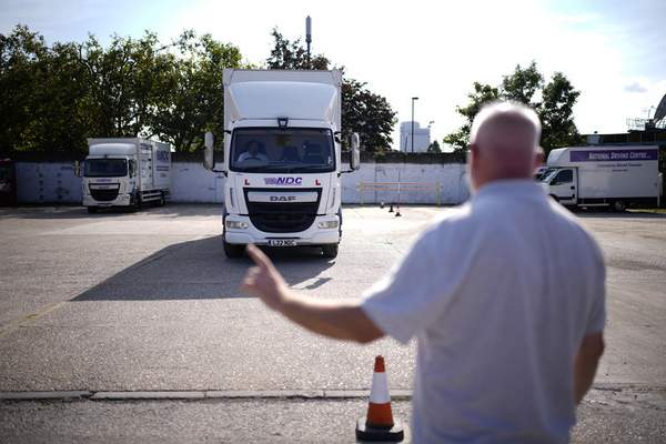 Associated Press An instructor directs a student truck driver this week at the National Driving Centre near London that has seen a recent increase in applicants.