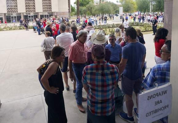 Associated Press People wait in line before being allowed inside to watch the election review hearing proceedings at the Arizona Capitol on Friday in Phoenix.