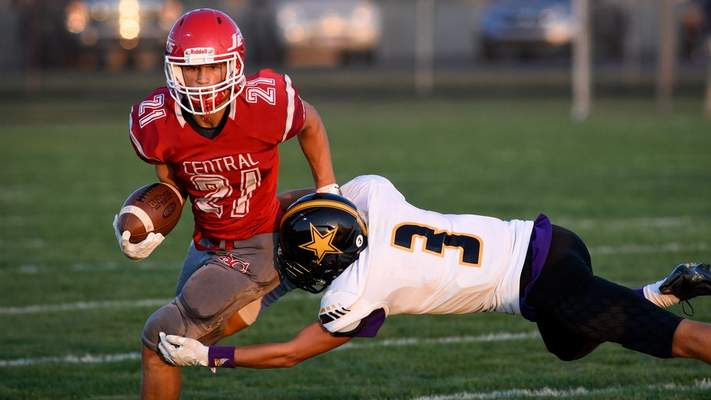 Mike Moore | The Journal Gazette Adams Central running back Alex Currie advances the ball in the first quarter against South Adams on Friday.