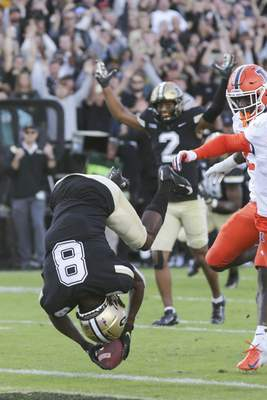 Associated Press Purdue wide receiver TJ Sheffield somersaults into the end zone in the fourth quarter Saturday at Ross-Ade Stadium in West Lafayette.