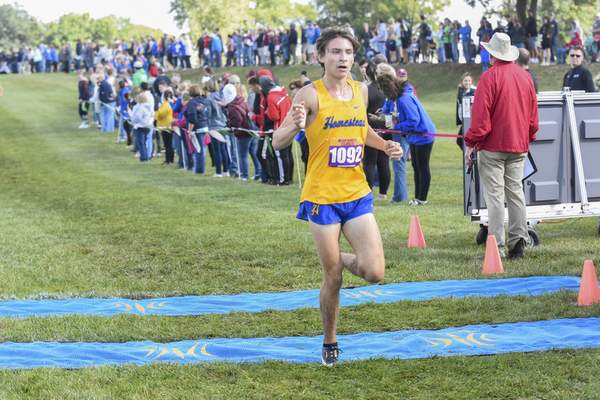 Michelle Davies | The Journal Gazette Homestead's Ethan Baitz finishes in fourth place during the Boys AAA Division of Saturday's New Haven Classic at Huntington University.