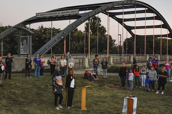 Mike Moore | The Journal Gazette Families of homicide victims participate in The National Day of Remembrance for Murder Victims  ceremony Saturday near the Martin Luther King Jr. Memorial Bridge north of downtown.