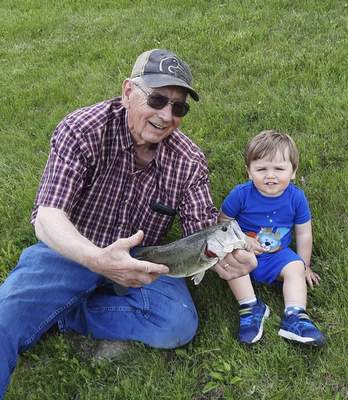 Charlie Procise, 19 months, caught this nice bass with a twister tail in May at Chuck Dewey's pondin southwest Fort Wayne.