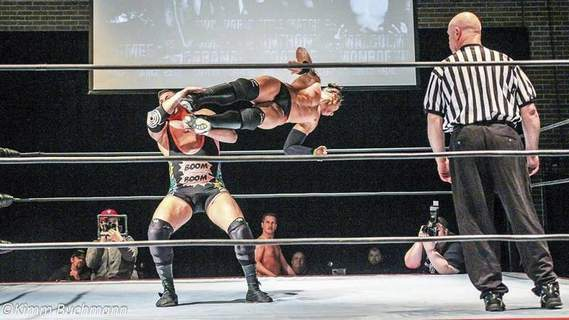 Courtesy photos Anthony Toatele, in air, connects on a drop kick against Colt Cabana. Toatele, the current title holder of both the heavyweight and Legends championships in Heroes and Legends, will put both belts on the line against Elijah Burke at Heroes and Legends XV at Memorial Coliseum on Saturday.