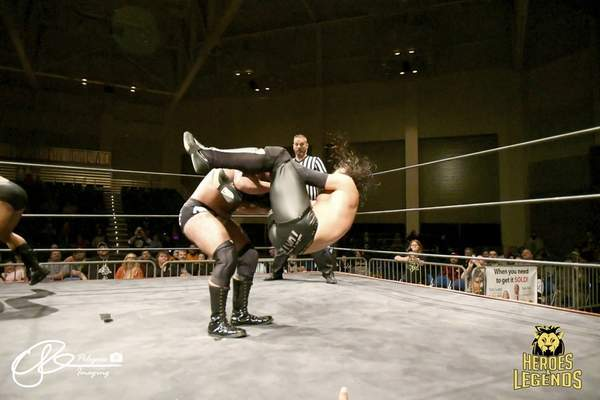 Courtesy photo  Anthony Toatele, right, attempts to take down his opponent at a past Heroes and Legends professional wrestling show.
