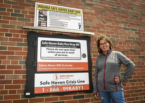 Photos by Mike Moore   The Journal Gazette Founder of Safe Haven Baby Boxes, Monica Kelsey, stands next to a baby box located at the Maumee Township Fire Station in Woodburn on Wednesday.