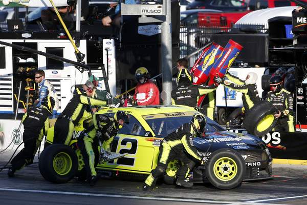 NASCAR Cup Series driver Ryan Blaney (12) makes a pit stop during a NASCAR Cup Series auto race at Las Vegas Motor Speedway, Sunday, Sept. 26, 2021, in Las Vegas. (AP Photo/Steve Marcus)