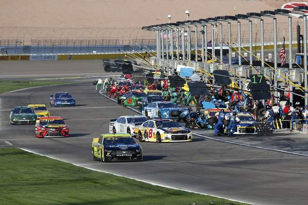 Drivers head into pit row during a NASCAR Cup Series auto race at Las Vegas Motor Speedway, Sunday, Sept. 26, 2021, in Las Vegas. (AP Photo/Steve Marcus)