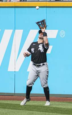 Chicago White Sox's Andrew Vaughn prepares to catch a fly ball hit by Cleveland Indians' Owen Miller during the fourth inning of a baseball game in Cleveland, Sunday, Sept. 26, 2021. (AP Photo/Phil Long)