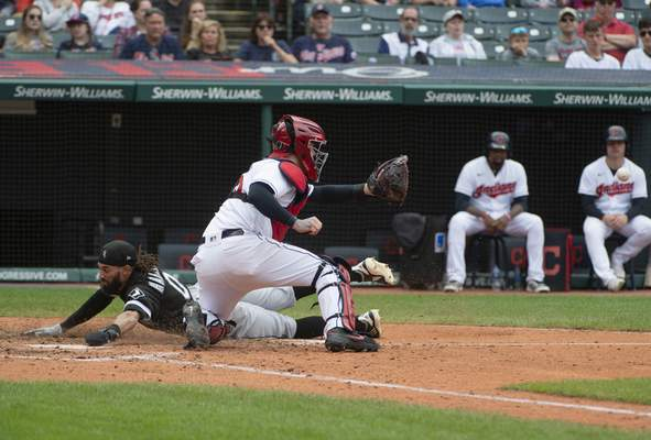 Chicago White Sox's Billy Hamilton, left, scores on a steal ahead of the tag of Cleveland Indians' Roberto Perez during the eighth inning of a baseball game in Cleveland, Sunday, Sept. 26, 2021. (AP Photo/Phil Long)