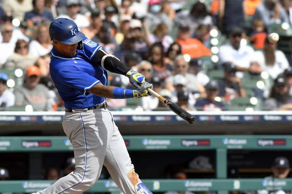 Kansas City Royals designated hitter Salvador Perez flies out to center field against the Detroit Tigers in the fourth inning of a baseball game, Sunday, Sept. 26, 2021, in Detroit. (AP Photo/Jose Juarez)
