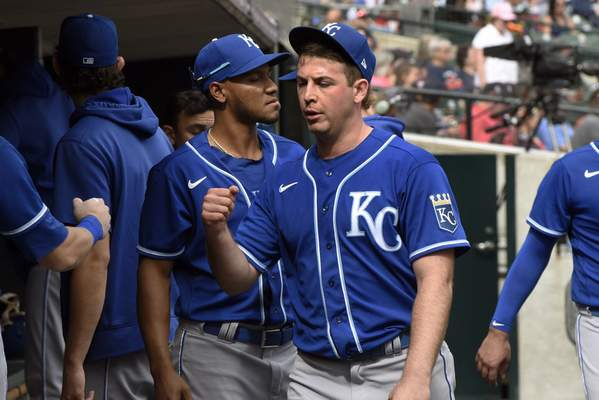 Kansas City Royals starting pitcher Kris Bubic, foreground, is congratulated in the dugout after the final out of the seventh inning of a baseball game against the Detroit Tigers, Sunday, Sept. 26, 2021, in Detroit. (AP Photo/Jose Juarez)