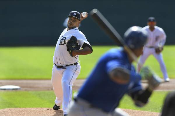 Detroit Tigers starting pitcher Wily Peralta, left, throws to Kansas City Royals designated hitter Salvador Perez in the first inning of a baseball game, Sunday, Sept. 26, 2021, in Detroit. (AP Photo/Jose Juarez)