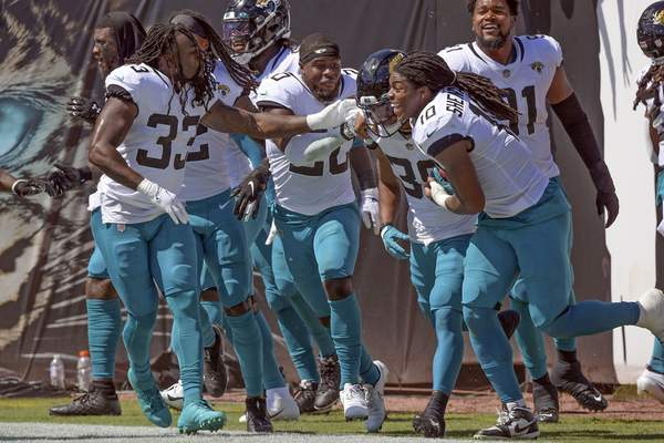 Jacksonville Jaguars players celebrate with wide receiver Jamal Agnew, second from right, after he ran back a missed field goal for a 109-yards for a touchdown against the Arizona Cardinals during the first half of an NFL football game, Sunday, Sept. 26, 2021, in Jacksonville, Fla. (AP Photo/Phelan M. Ebenhack)