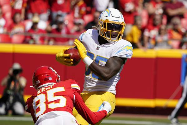 Los Angeles Chargers' Larry Rountree III (35) is tackled by Kansas City Chiefs' Marcus Kemp (85) during the first half of an NFL football game, Sunday, Sept. 26, 2021, in Kansas City, Mo. (AP Photo/Ed Zurga)