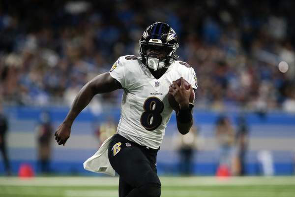 Baltimore Ravens quarterback Lamar Jackson (8) runs the ball against the Detroit Lions in the first half of an NFL football game in Detroit, Sunday, Sept. 26, 2021. (AP Photo/Tony Ding)