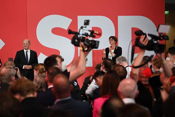 Olaf Scholz, Finance Minister and SPD candidate for Chancellor, left, attends the election party at Willy Brandt House in Berlin, Sunday, Sept. 26, 2021. (Britta Pedersen/dpa via AP)