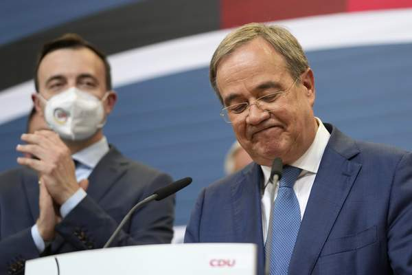 Armin Laschet, the top CDU candidate grimaces after the German parliament elections at the Christian Democratic Union, CDU, party's headquarters in Berlin, Sunday, Sept. 26, 2021. (AP Photo/Markus Schreiber)